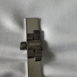 Other - Silver tone tie clip with a decorative front